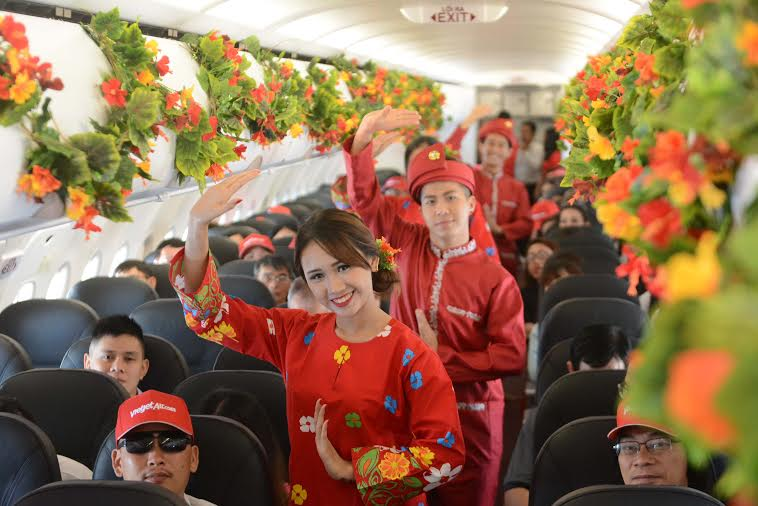 Dancers performing a traditional Malay dance on board the inaugural flight from HCMC
